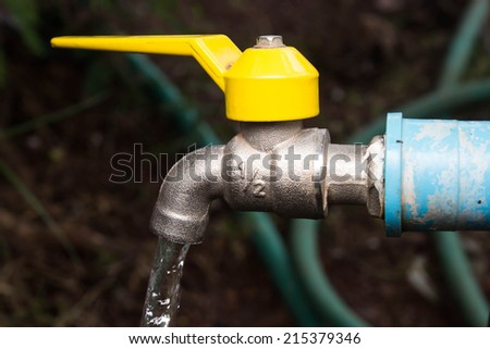 Open water tap - stock photo