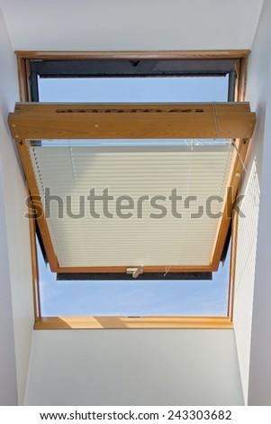 open window on the roof - stock photo