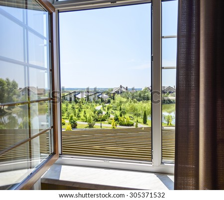 Open window to the garden in a sunny day - stock photo