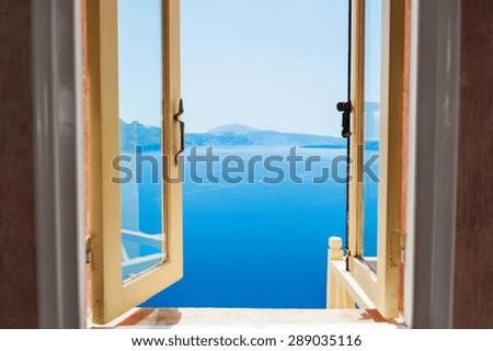 Open window with beautiful sea view. Santorini island, Greece - stock photo