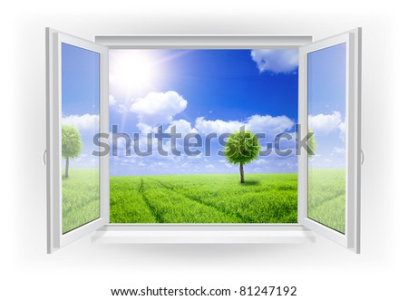 Open window with green field on a background - stock photo