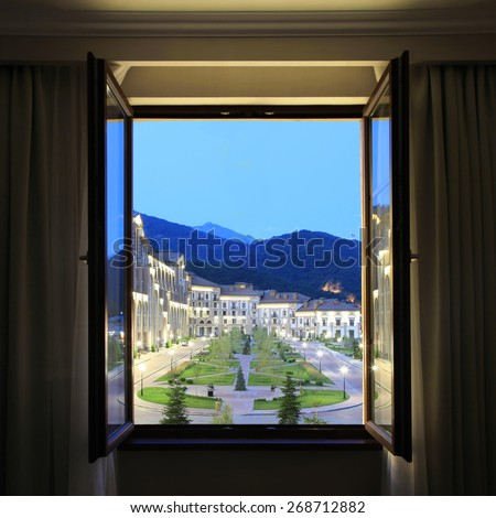 Open window with mountains view. - stock photo