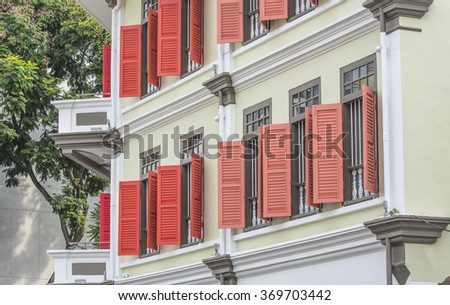 Open windows on white building wall. - stock photo