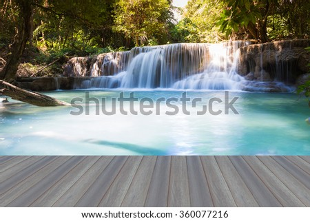 Open wooden floor, Spring blue stream water falls in national park of Thailand - stock photo