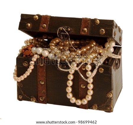 Open wooden treasure chest with valuables isolated with clipping path on white background - stock photo