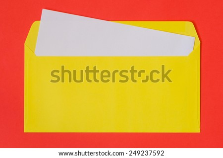 open yellow envelope with  blank paper on red  background - stock photo