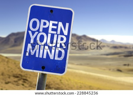 Open Your Mind sign with a desert background - stock photo