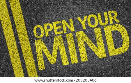 Open your Mind written on the road - stock photo