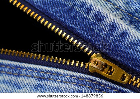 Open zipper of blue jeans  with black opening - stock photo