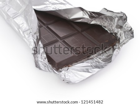 Opened black chocolate bar in a foil wrap - stock photo