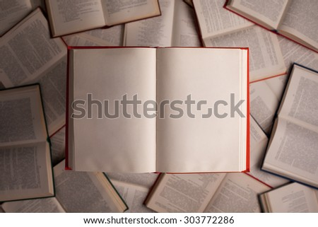 opened book against other books in background