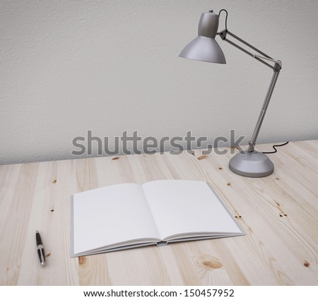 opened book and pen on the table with lamp - stock photo