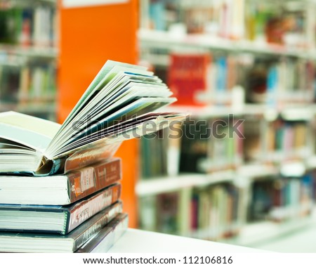 opened book in library close up - stock photo