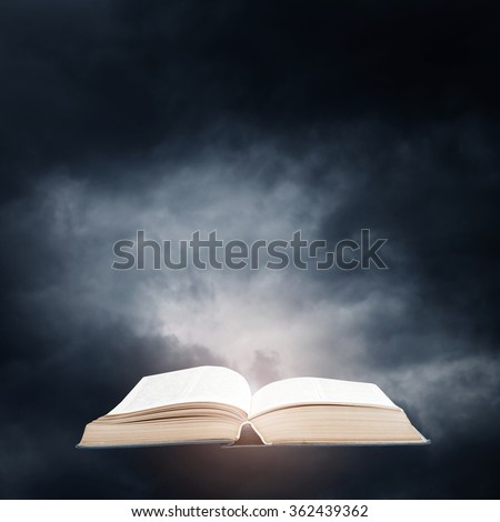 Opened book on a dark sky background