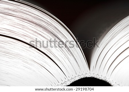 Opened book on dark background - black and white