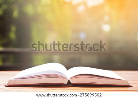 opened book on table  - stock photo