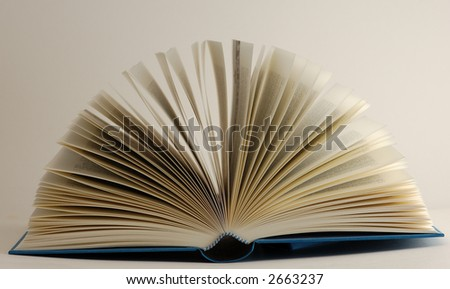 Opened book on white background close-up