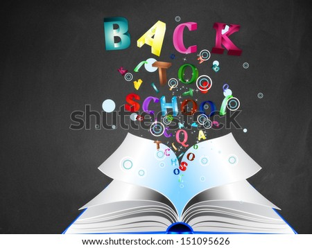 Opened book with colorful letters bursting out of it on blackboard background.