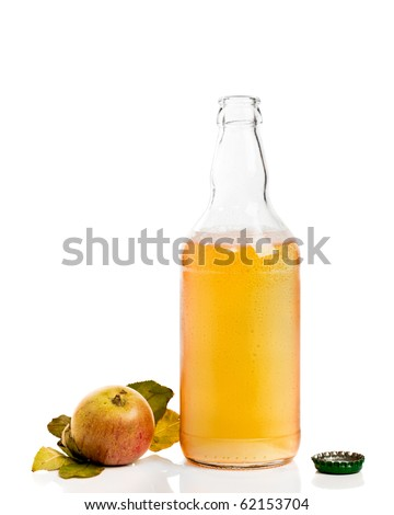 Opened bottle of cider with apples on white background - stock photo