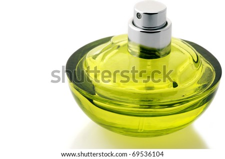 Opened bottle of green perfume isolated on white background.