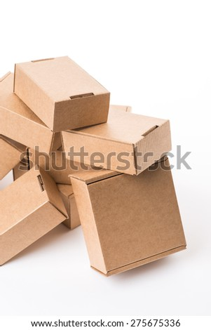 Opened brown cardboard box over the white background, isolated