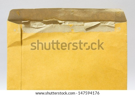 Opened brown envelope on white background - stock photo
