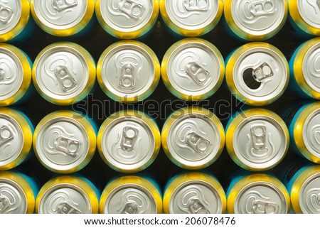 opened canned beer and many unopened - stock photo