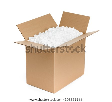 Opened cardboard container is filled with foam plastic shaving, isolated, white background - stock photo