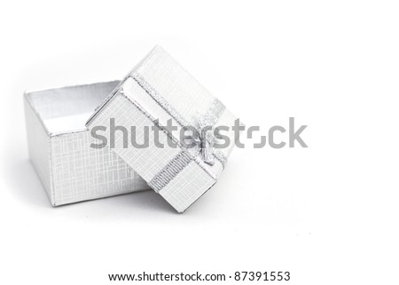 opened christmas silver gift-box on white background, with silver ribbon - stock photo