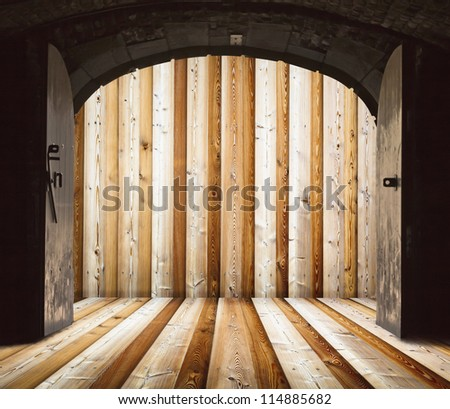 Opened church doors, behind wooden wall - stock photo
