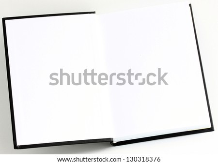 Opened datebook (book) with blank pages; flyleaf of a book; copy space - stock photo