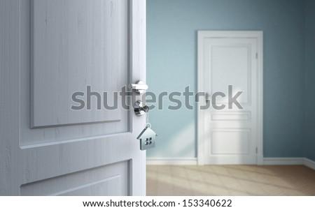 opened door in blue room - stock photo
