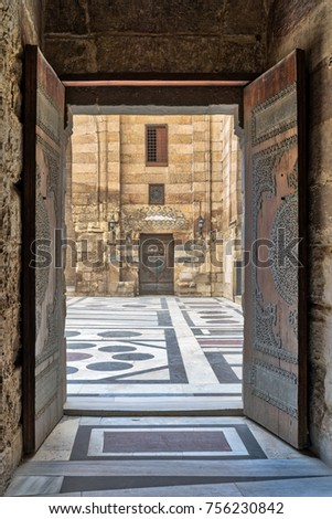 Opened door leading to the courtyard of Sultan Barquq mosque, Old Cairo, Egypt