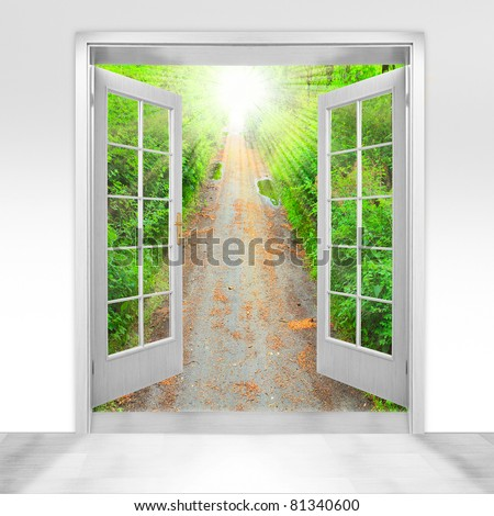 Opened door to early morning in green garden - conceptual image - environmental business metaphor. - stock photo