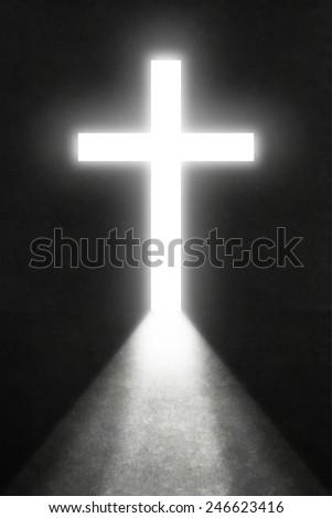 Opened door with bright light cross - stock photo
