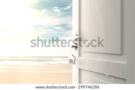 opened door with key in lock in beach - stock photo
