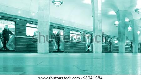 Opened doors train on metro station - stock photo