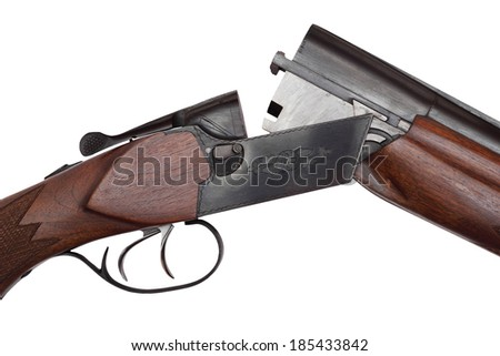 Opened double-barrelled hunting gun close-up photo isolated on white background - stock photo