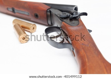 Opened double-barrelled hunting gun with two bullets close-up photo isolated on white background - stock photo