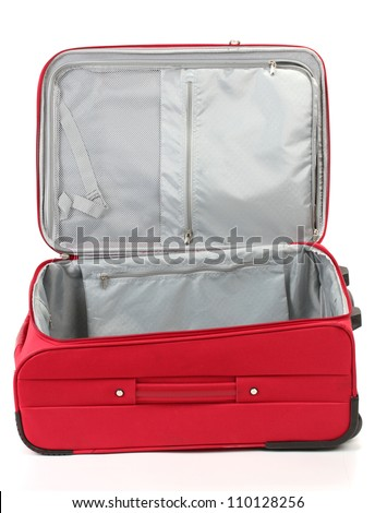 Opened empty red suitcase isolated on white - stock photo