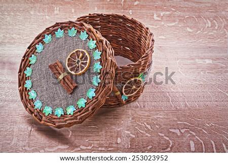 opened empty wicker basket on old wooden board  - stock photo