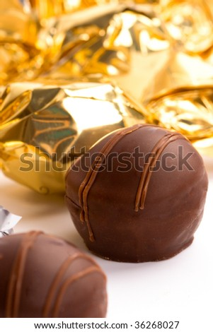 opened foil chocolate candy closeup - stock photo