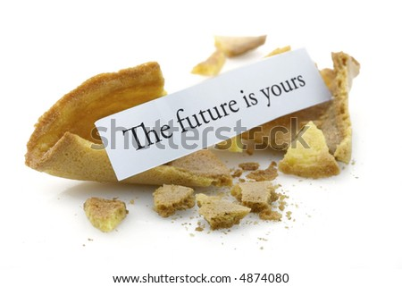 Opened fortune cookie with a positive message - the future is yours - stock photo