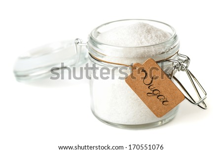 Opened glass jar with sugar. Isolated on white. - stock photo