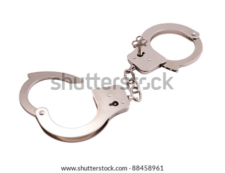 opened handcuffs with a key isolated on white background - stock photo