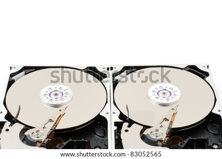 Opened hard disk drive on a white background