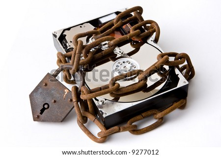 Opened hard disk secured with a strong iron chain and padlock - stock photo