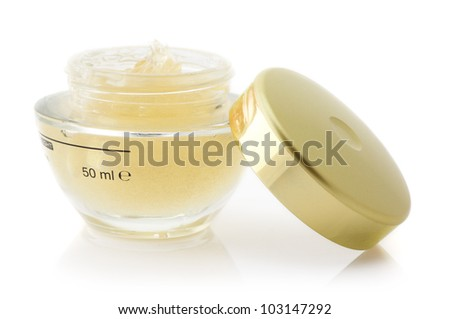 Opened jar of cosmetic cream isolated on white background.