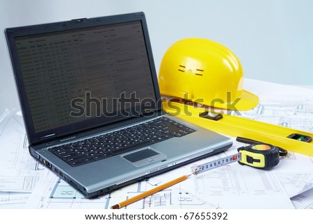 Opened laptop with tools for architectural design - stock photo