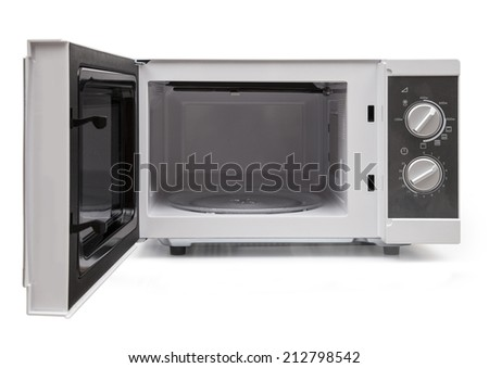 Opened microwave  on white background